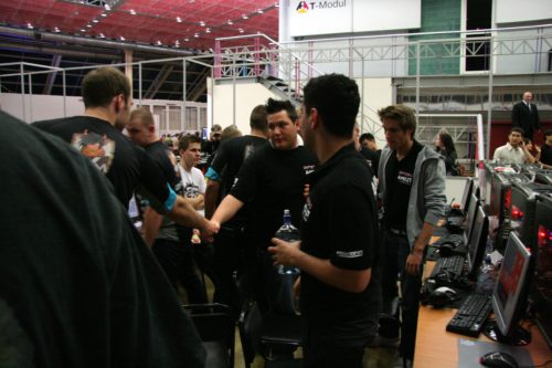 TaZ and zonic shaking hands.